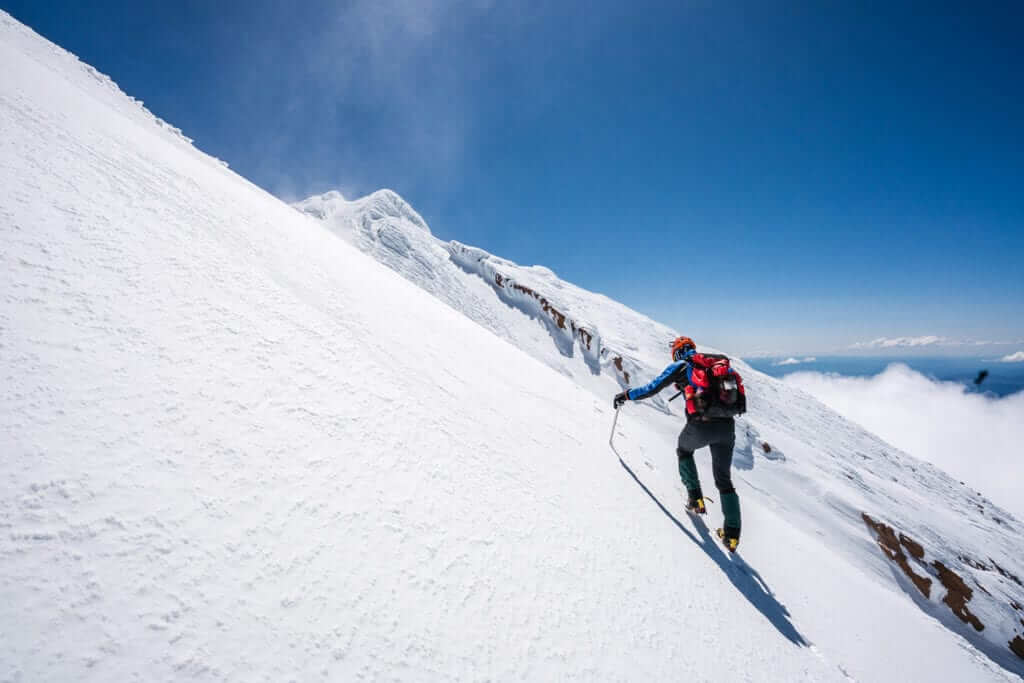 Man mountaineering on a snowy mountain